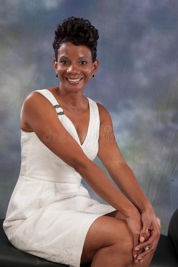 Woman smiling. Pretty black woman with happy attitude royalty free stock images