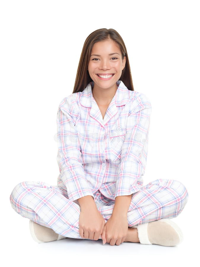 Woman smiling sitting in pajamas stock photos