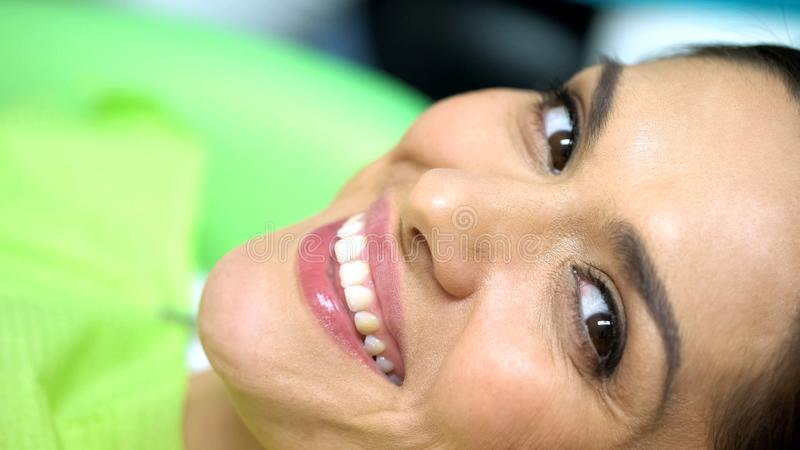 Woman smiling after successful mole removal, skin cancer awareness, health royalty free stock images