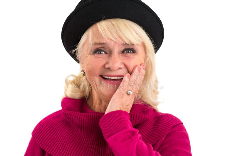 Woman smiling and touching face. Cheerful lady isolated stock photography