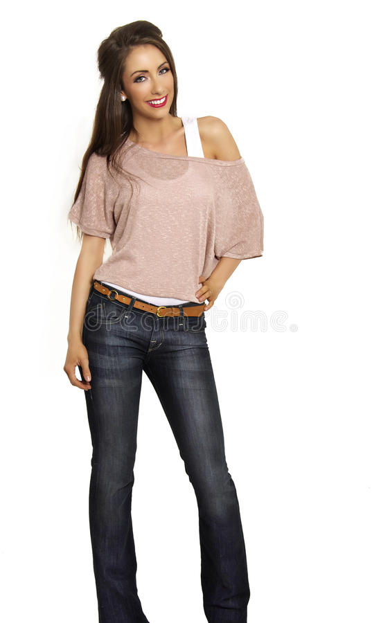 Woman smiling wearing jeans and casual top