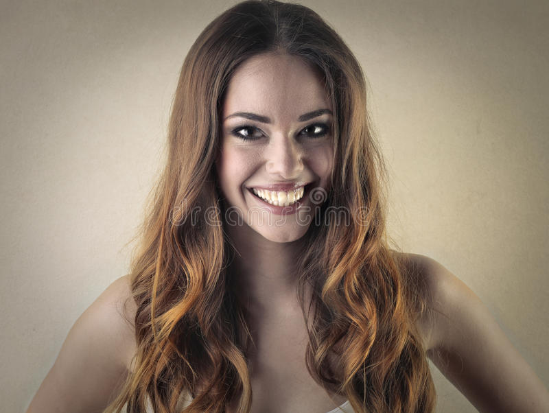 Woman smiling widely stock photo