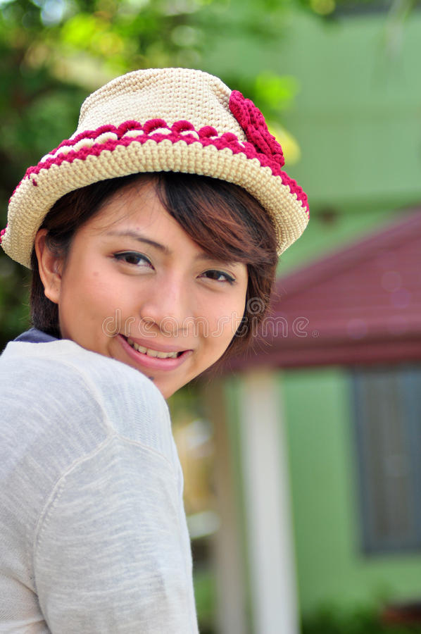 Woman smiling with wool hat royalty free stock image
