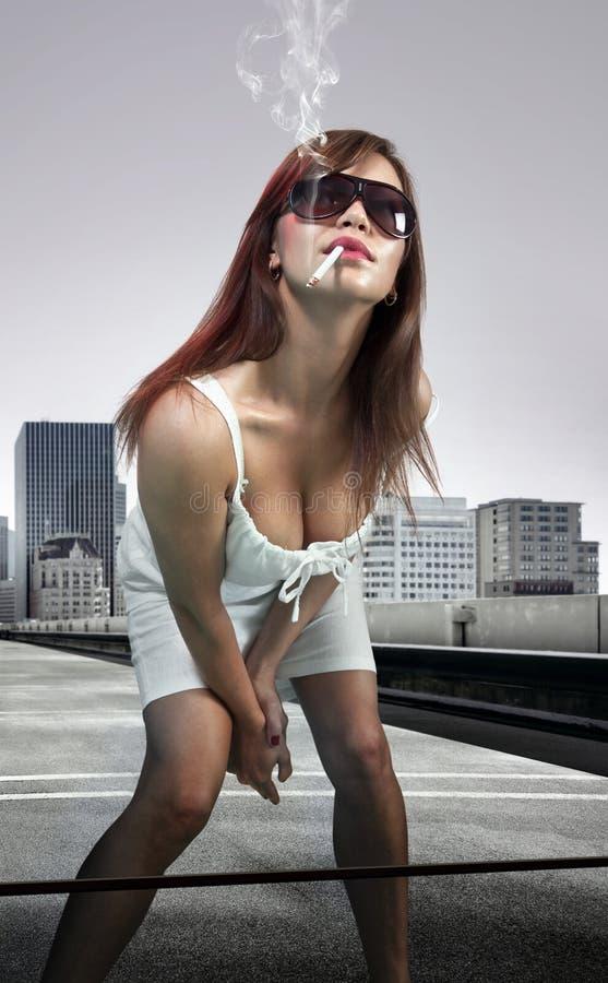 Download Woman smoking cigarette stock image. Image of cigarette - 24893733