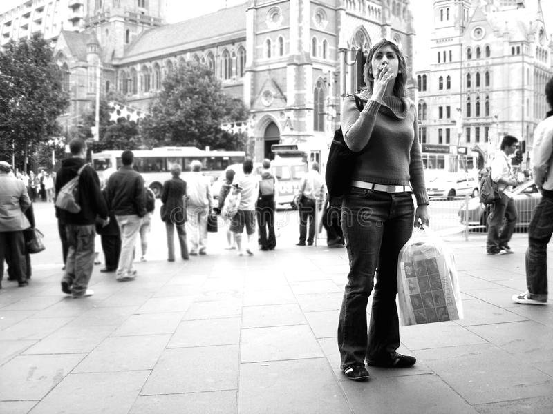 Download A Woman Smoking A Cigarette At The Steps Of Flinders Street Station Editorial Stock Photo - Image: 83721378
