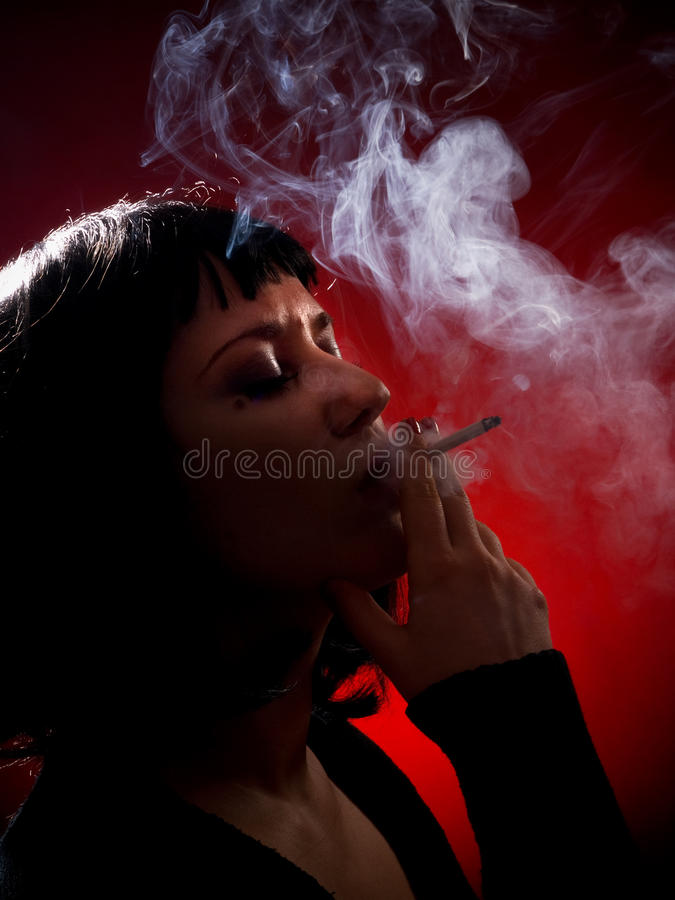 Woman smoking. Shot from above royalty free stock photos