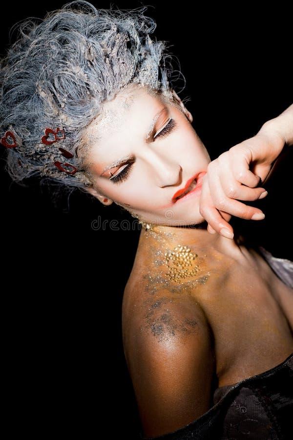 Woman smudging lipstick stock photos