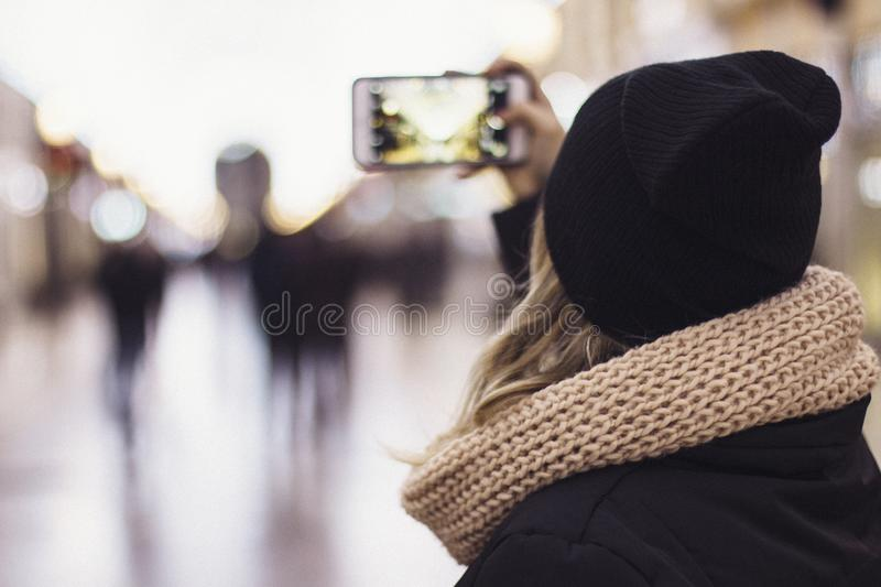 Woman snapping photo stock photos