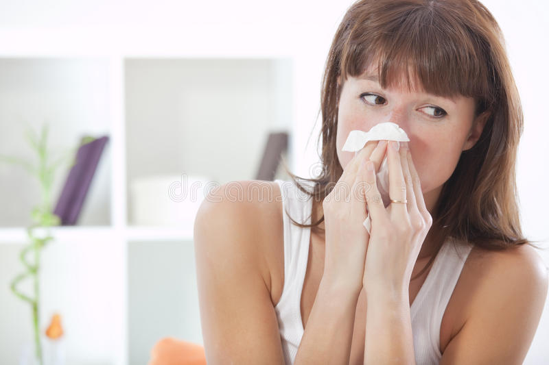 Woman sneezing stock photography