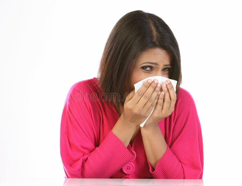 Woman Sneezing To A Paper Handkerchief Stock Image
