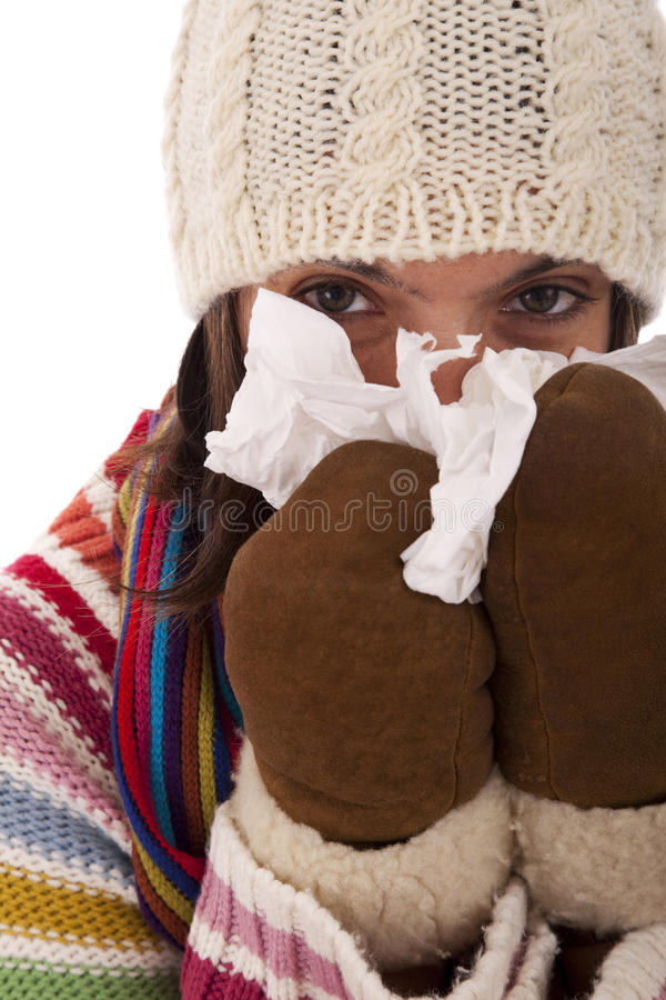 Download Woman sneezing to a tissue stock photo. Image of healthcare - 16519070