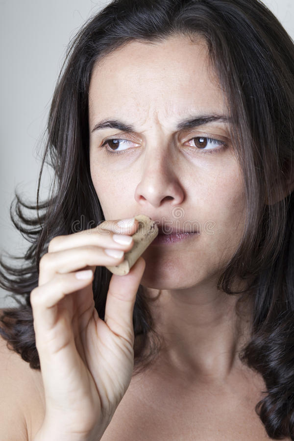 Woman sniffing on wine cork from bad wine royalty free stock image