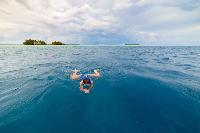 Woman snorkeling in caribbean sea, turquoise blue water, tropical island. Indonesia Banyak Islands Sumatra, tourist diving travel stock photo