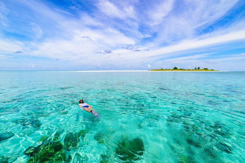 Woman snorkeling on coral reef tropical caribbean sea, turquoise blue water. Indonesia Wakatobi archipelago, marine national park royalty free stock photography