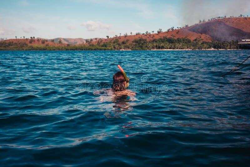 Woman snorkeling near tropical island royalty free stock photo