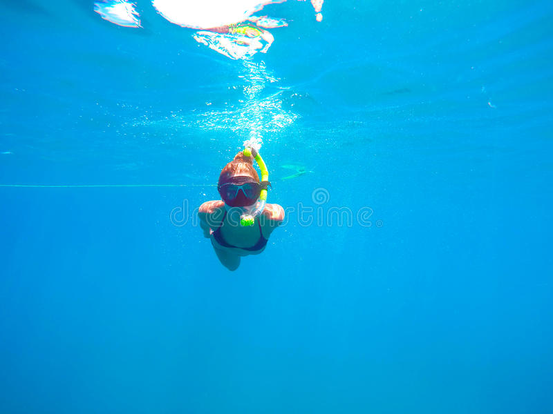 Woman snorkeling royalty free stock photography