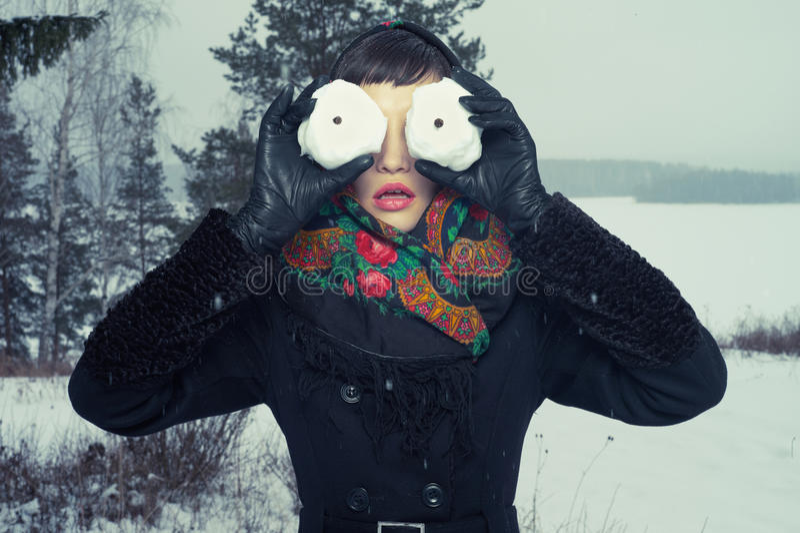 Woman with snow-balls stock photo