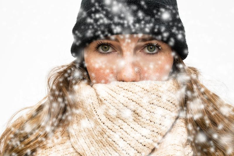 Woman in the Snow with winter wearing, wrapped in winter cap and scarf looking cold isolated on white background stock photos