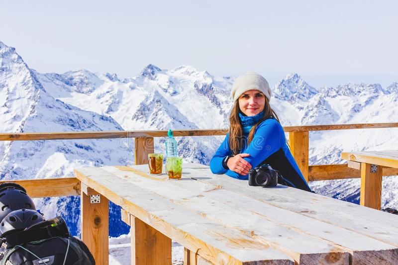 Woman snowboarder relaxing royalty free stock photos