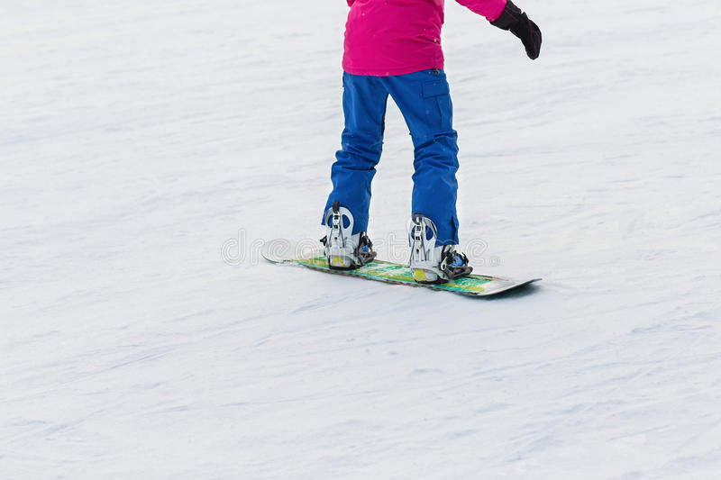Woman snowboarder on the slopes frosty winter day stock photo