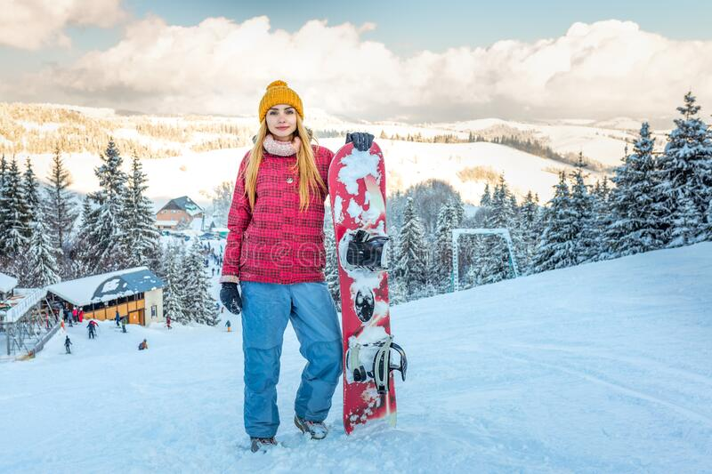 woman snowboarder winter sports in snowy forest stock image