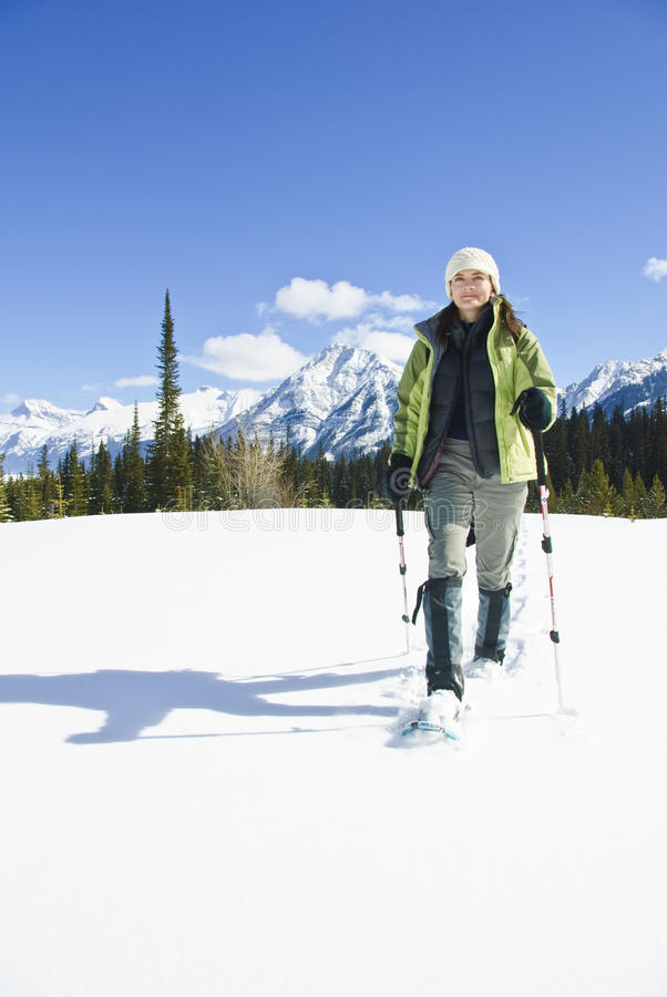 Download Woman Snowshoeing In The Canadian Rockies Stock Image - Image: 9898467