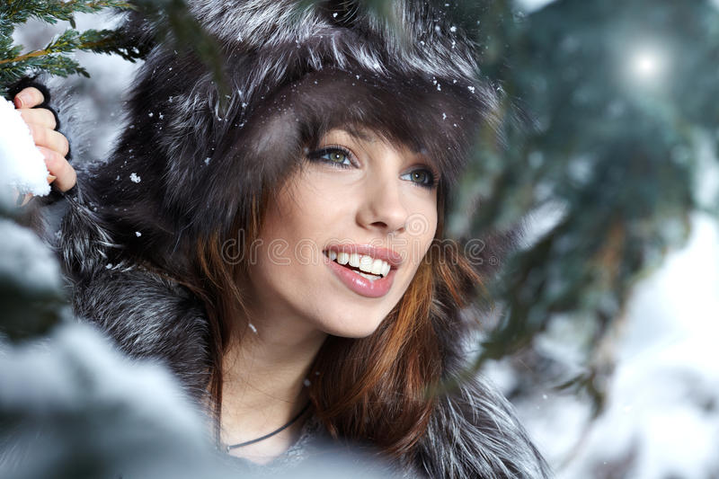 Woman in snowy winter outdoors stock images