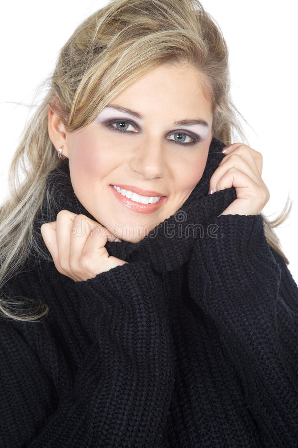 Woman snuggles up in sweaters royalty free stock photography