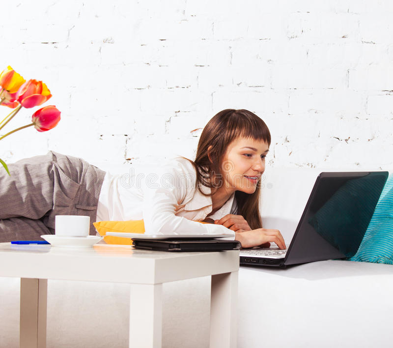 Download Woman On The Sofa With Laptop Stock Image - Image: 27054987