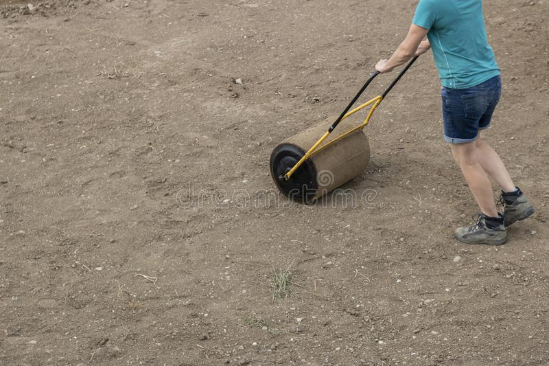 A woman with a soil roller royalty free stock photos