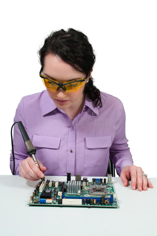 Woman soldering royalty free stock photo