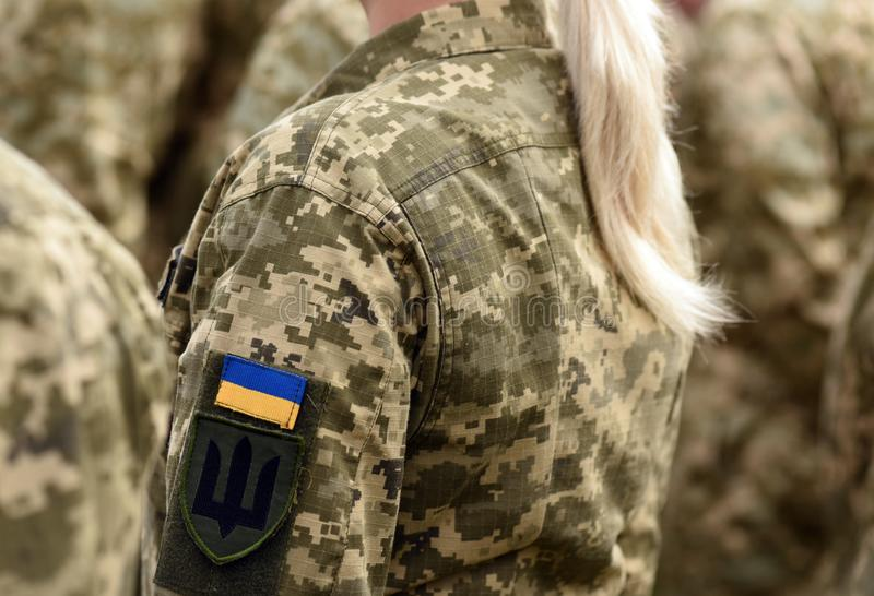 Woman soldier. Woman in army. Ukraine military uniform. Ukrainian troops.  royalty free stock photo