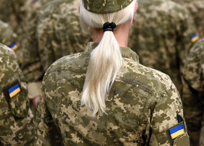 Woman soldier. Woman in army. Ukraine military uniform. Ukrainian troops stock photo
