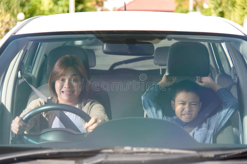 Woman and son in car stock photography