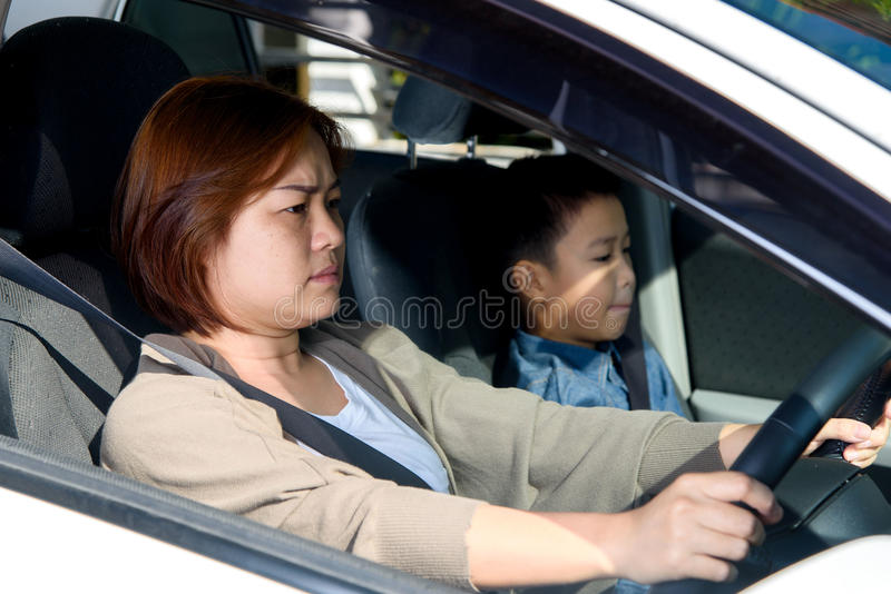 Woman and son in car royalty free stock images