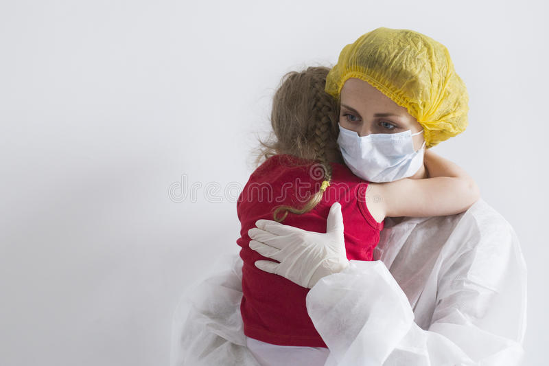 Woman soothes young girl stock photography
