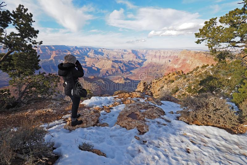 Woman on the South Rim Trail in the Grand Canyon. royalty free stock photos