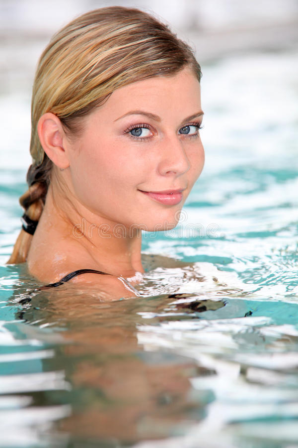 Woman in spa bath stock photography