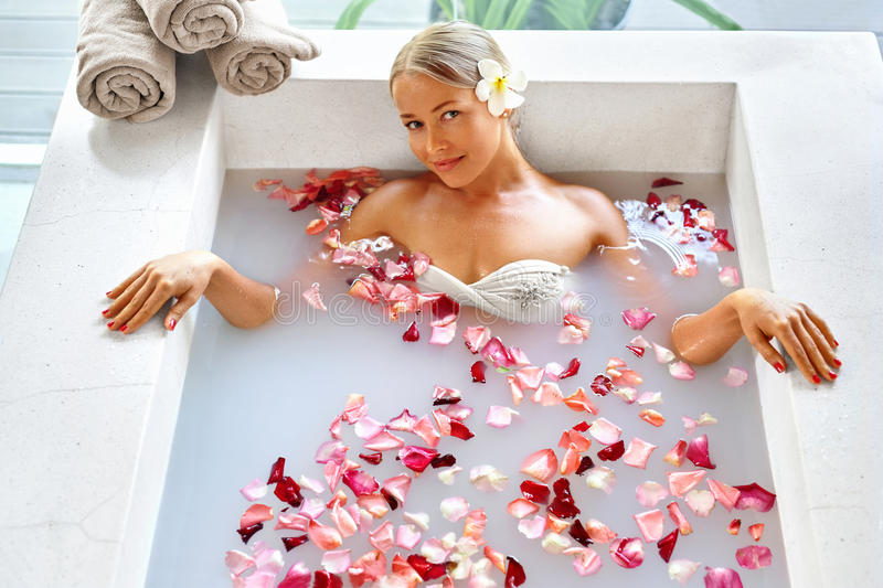 Woman Spa Flower Bath. Aromatherapy. Relaxing Rose Bathtub. Beauty royalty free stock images