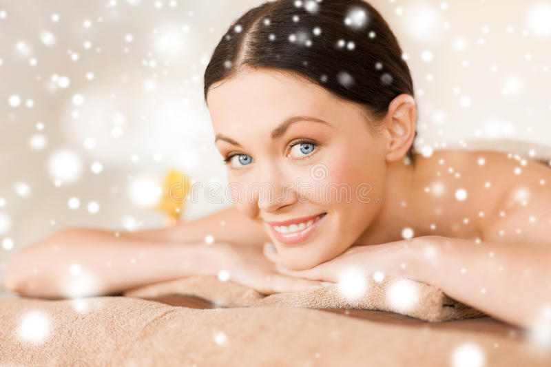 Woman in spa. Health and beauty concept - woman in spa salon lying on the massage desk royalty free stock photos