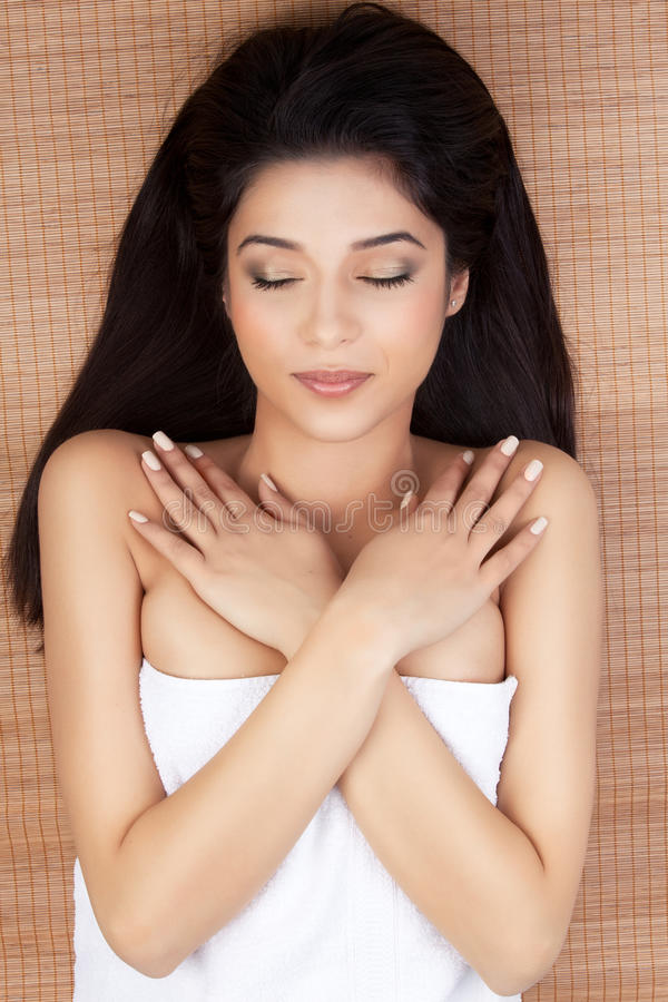 Download Woman At A Spa, Lying On Her Back, Smiling, Cl Royalty Free Stock Images - Image: 18962419