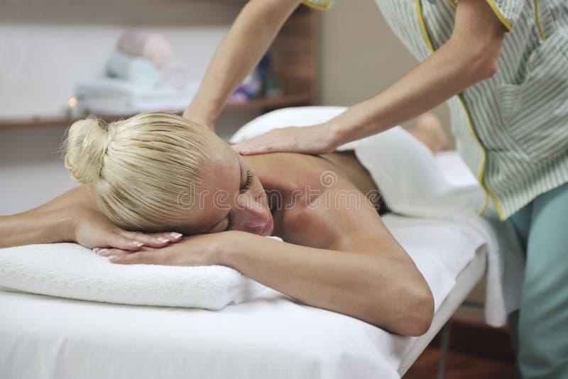 Woman At Spa And Wellness Back Massage Royalty Free Stock Photo