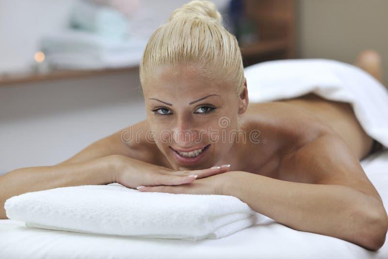 Woman at spa and wellness back massage. Beautiful young woman at spa and wellness back massage treatment stock image