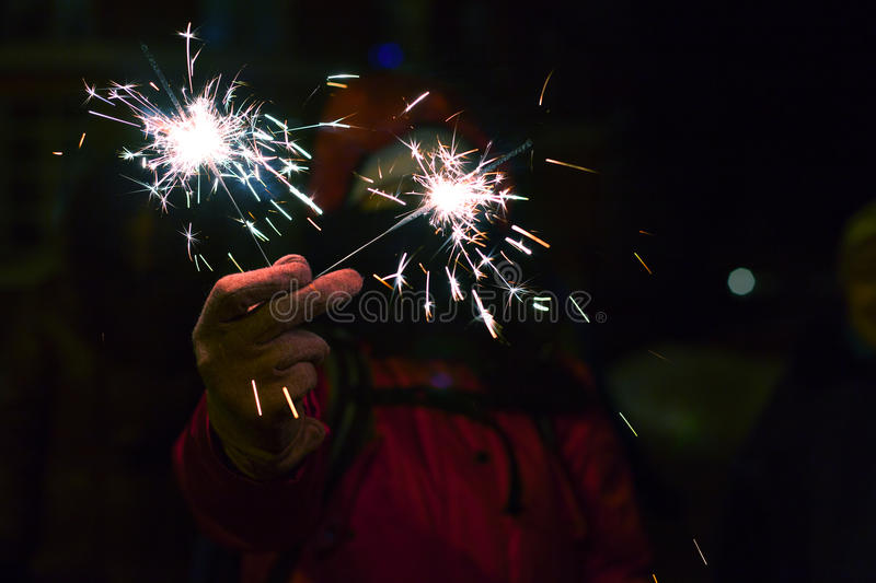 Woman with sparkler at winter. royalty free stock photo