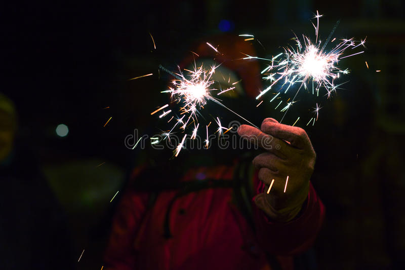 Woman with sparkler at winter. stock images