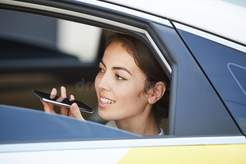 Woman Speaking by Phone in Car royalty free stock photos