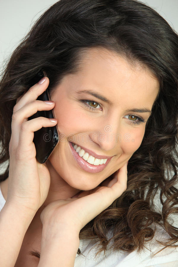 Woman Speaking On The Telephone Stock Image