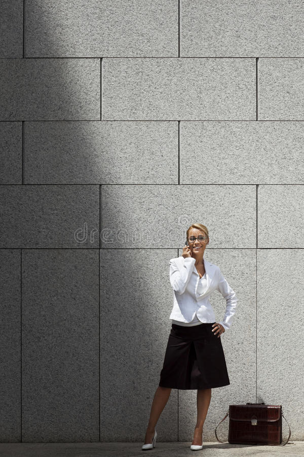 Download Woman Speaking On Telephone Near Office Stock Image - Image: 27585239