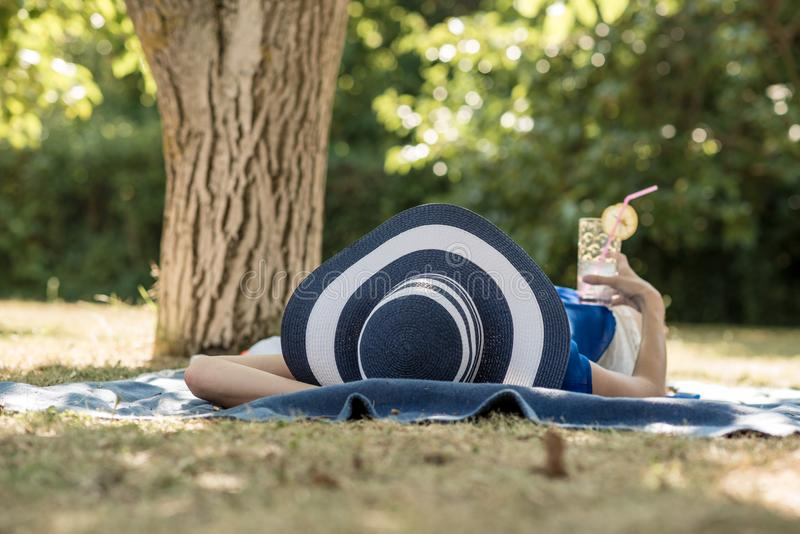 Woman spending a relaxing day in the garden stock images