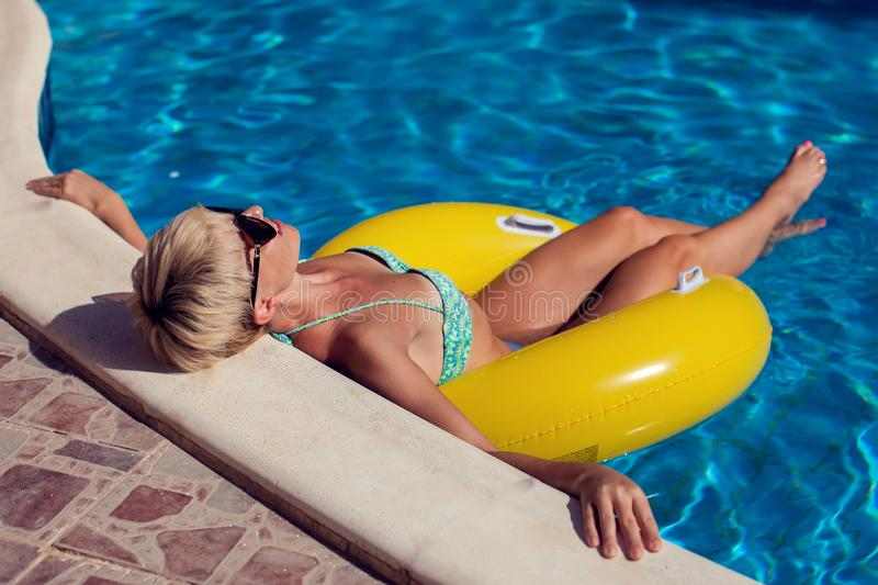 Woman spends time and has relax on the pool. People, travel, summer and holiday concept royalty free stock photos